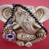 Onyx and Lotus OM Pendant, Bracelet